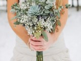 a greenery wedding bouquet with succulents, eucalyptus, thistles and baby's breath looks really unusual and cool
