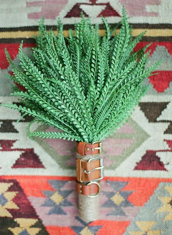 a boho or cowboy wedding bouquet of green branches is a cool idea for a modern boho, woodland or cowboy bride