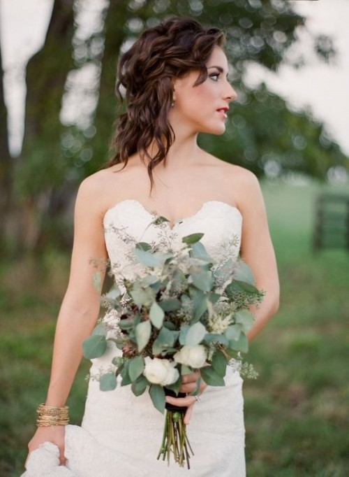 a seeded eucalyptus wedding bouquet with some white blooms is a cool and fresh option for a modern bride