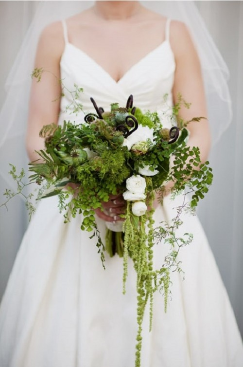 a textural greenery wedding bouquet with cascading touches, white blooms, some lotus and other stuff
