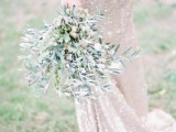 an olive green wedding bouquet of branches and with olives looks fresh, cool and airy and feels like Tuscany at once