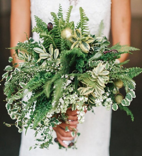 a textural greenery wedding bouquet with various types of greenery and various shades of green, with soem ferns and lotus