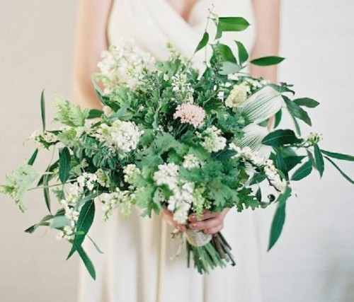 a lush textural greenery wedding bouquet with soem white and pink blooms for a more eye-catching look