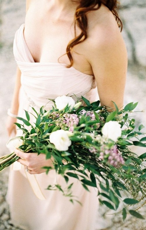 a greenery wedding bouquet with a catchy shape dotted with white and pink flowers is ideal for spring