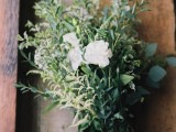 a textural greenery wedding bouquet with some blooms – white roses and mini flowers is a simple and casual idea