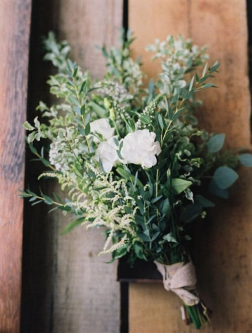 a textural greenery wedding bouquet with some blooms - white roses and mini flowers is a simple and casual idea