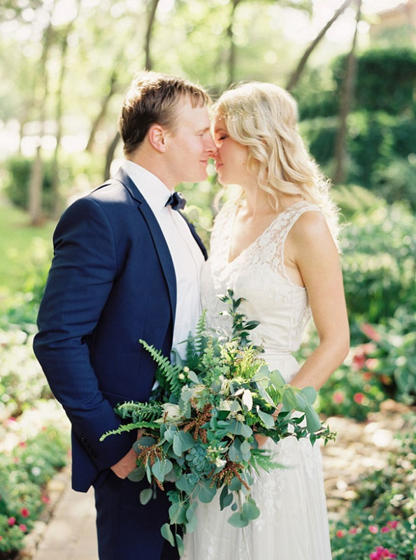 a textural greenery wedding bouquet of various types of greenery and some dried elements for a spring or summer wedding