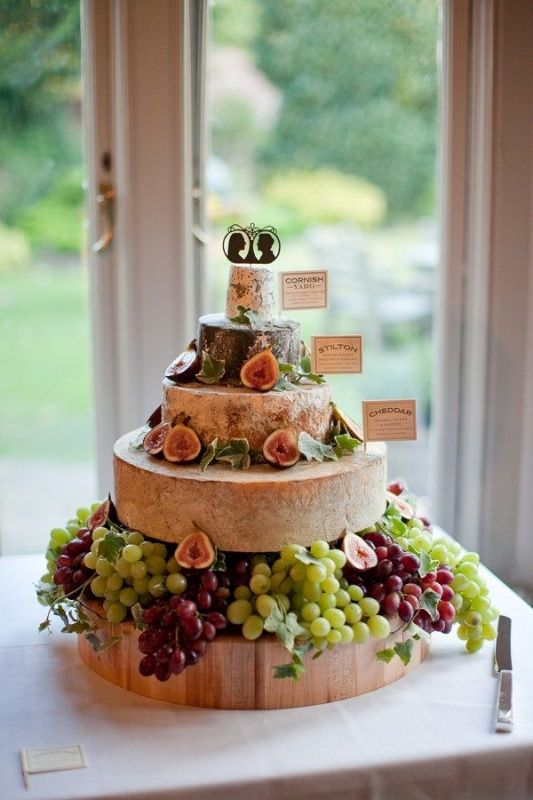 Picture Of non traditional cheese wheel wedding cakes  12