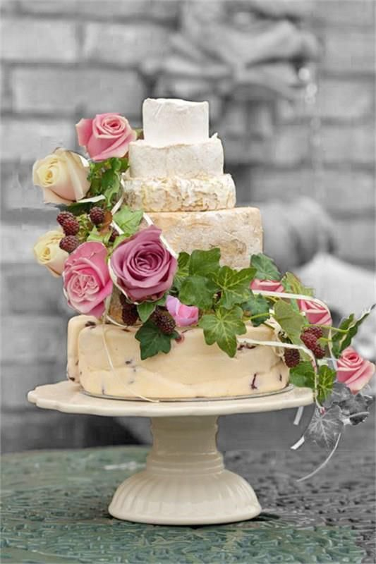 Picture Of non traditional cheese wheel wedding cakes  17