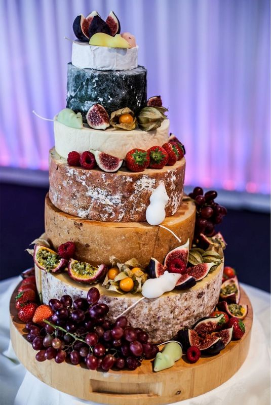 Picture Of non traditional cheese wheel wedding cakes  20