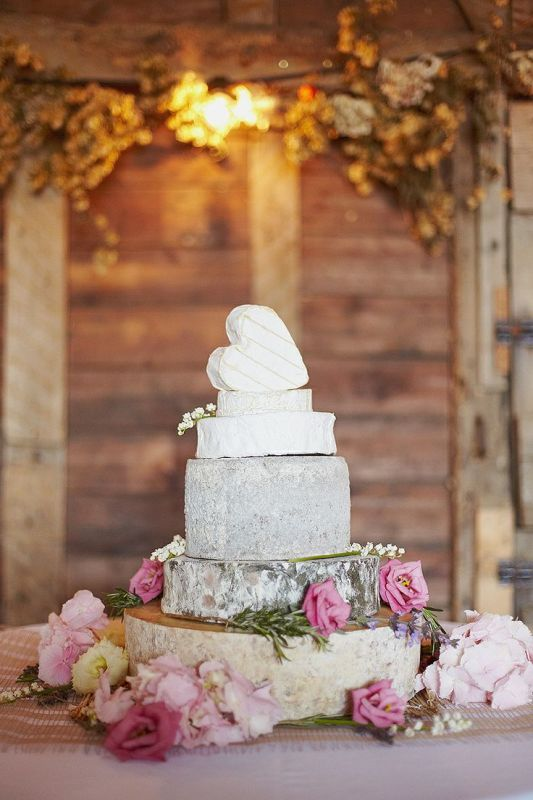 Picture Of non traditional cheese wheel wedding cakes  25