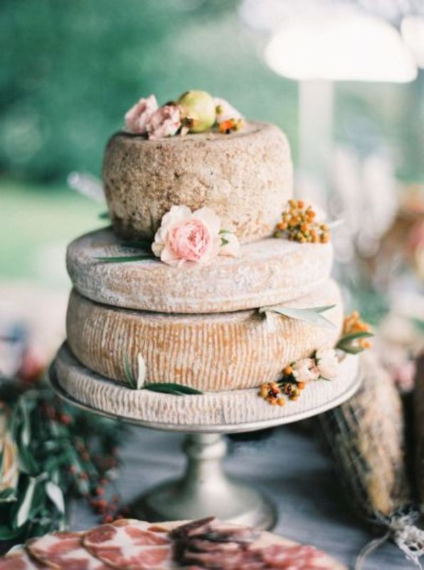 Picture Of non traditional cheese wheel wedding cakes  3
