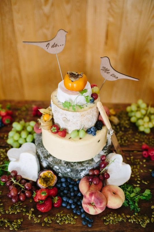 Picture Of non traditional cheese wheel wedding cakes  5