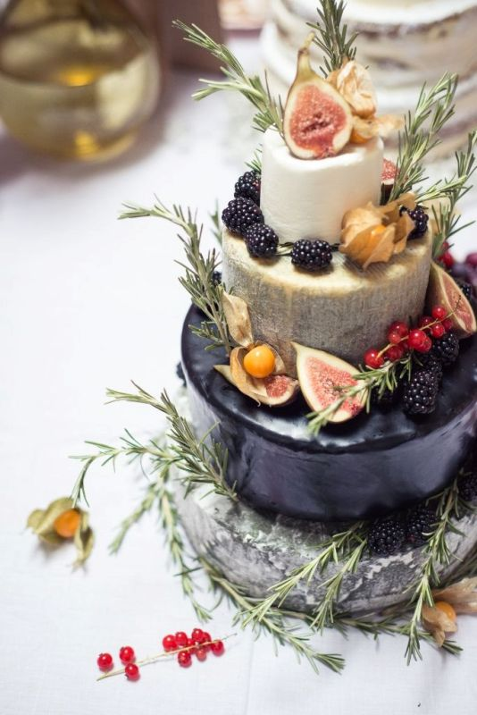 Picture Of non traditional cheese wheel wedding cakes  9