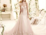 a blush strapless lace wedding ballgown with a sash and a flower on the waist is a romantic and chic option