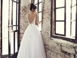 a vintage wedding ballgown with a full skirt, an open back, spaghetti straps and a lace bodice is wow