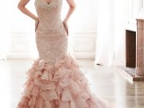 a blush mermaid wedding dress of lace, with rhinestones and a ruffled skirt with a train is a very tender and girlish idea