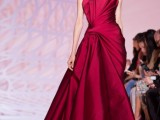 a sculptural burgundy strapless wedding ballgown, a draped bodice and a skirt plus a train is a refined and chic modern outfit for a Valentine bride