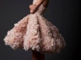 a blush flower strapless A-line wedding dress with a super full pleated skirt is a lovely and bold option