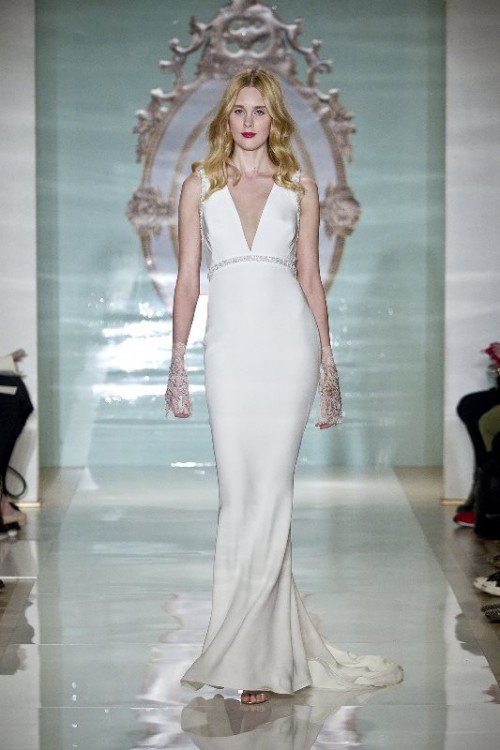 a modern plain plunging neckline wedding dress with an embellished sash and sheer embellished sleeves