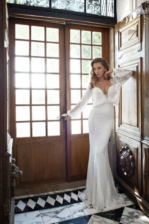 a sexy ribbed mermaid wedding dress with long sleeves and a deep plunging neckline