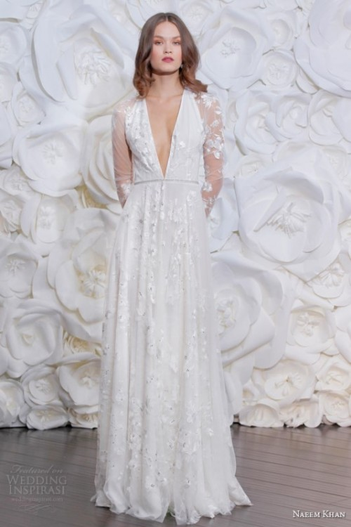 a romantic floral applique A-line wedding dress with a plunging neckline and long sleeves