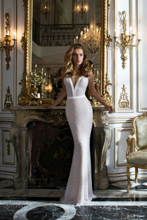 a sparkling sheath wedding dress with a plunging neckline and a train