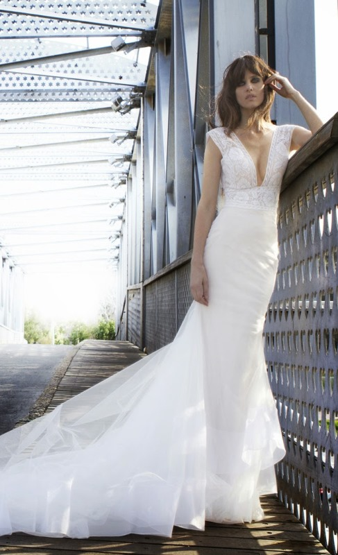 a mermaid wedding dress with no sleeves, a plunging neckline, a lace bodice and a plain skirt with a train