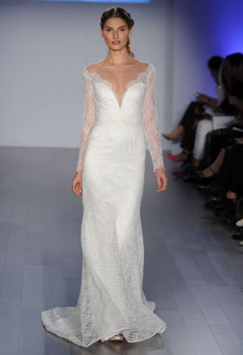 a lace off the shoulder wedding dress with a plunging neckline and long sleeves plus a train