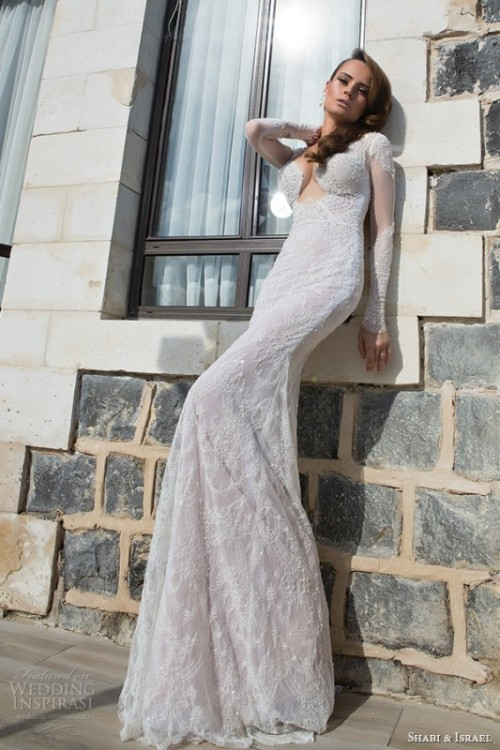 a white sheath lace wedding dress with a plunging neckline and long and sheer sleeves