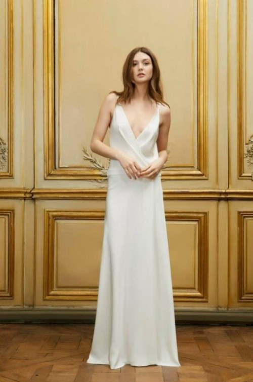 a minimalist plain spaghetti strap wedding dress with a plunging neckline and a draped bodice