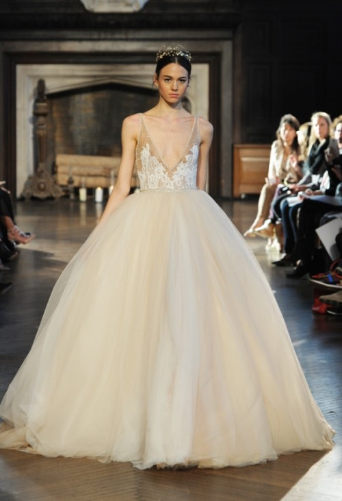 a wedding ballgown with a white lace bodice on straps and a full layered skirt plus a plunging neckline