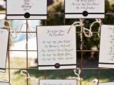 a stylish rustic and vintage seating chart with notes and stamps plus twine is a stylish and cute idea