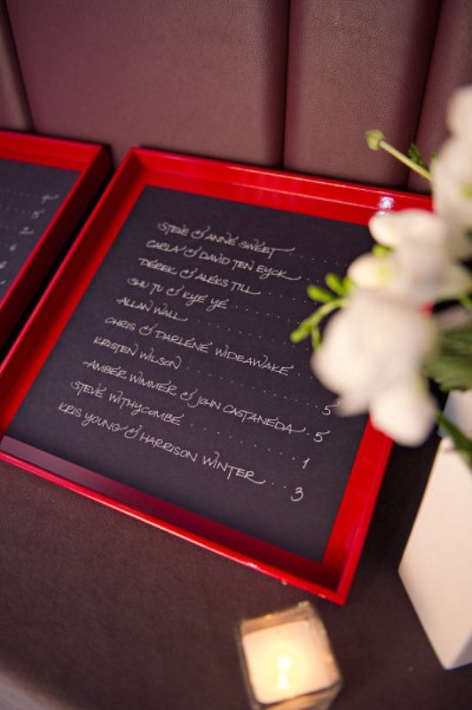 chalkboard seating charts in red frames are a fun and cool idea for a modern wedding