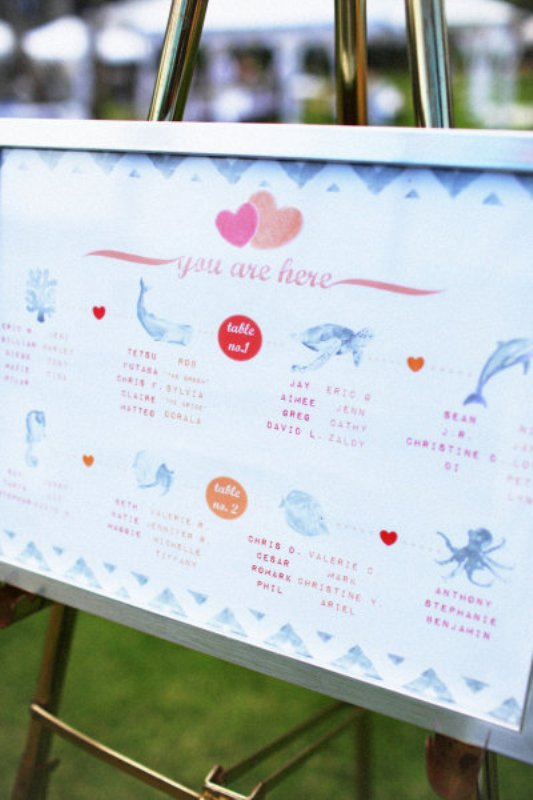 a pastel marine inspired wedding seating chart with various sea creatures is a cool idea for a beach or coastal wedding