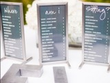 a modern seating chart of various pieces in simple frames is a stylish and very simple idea for a modern wedding