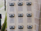 a retro wedding seating chart with cassettes is a cool idea for a nostalgic wedding