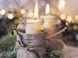 jars wrapped with bark and evergreens and with candles inside look super cool and super cozy