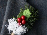 a rustic boutonniere of evergreens, berries, leaves and some twine for a cute accent