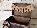 a wood box with a burlap bunner is nice for cards and wishes to your couple