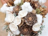 a rustic winter wedding bouquet pinecones, fabric blooms, twigs, cotton and burlap