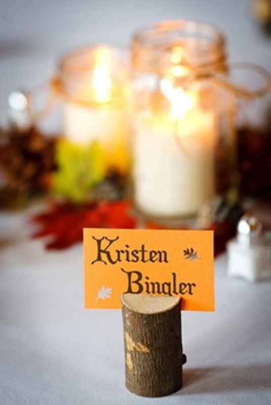 a tree stump with a card is a nice place card idea for a fall or winter woodland wedding