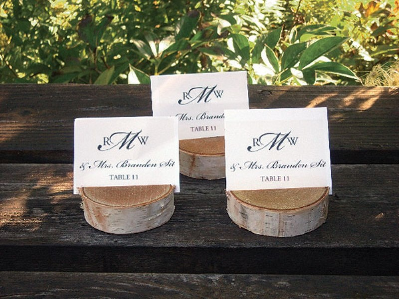 wooden slices with escort cards are nice for a rustic or woodland wedding