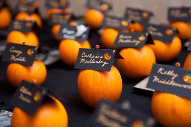 mini pumpkins with black cards are nice escort cards to rock and they feel like fall