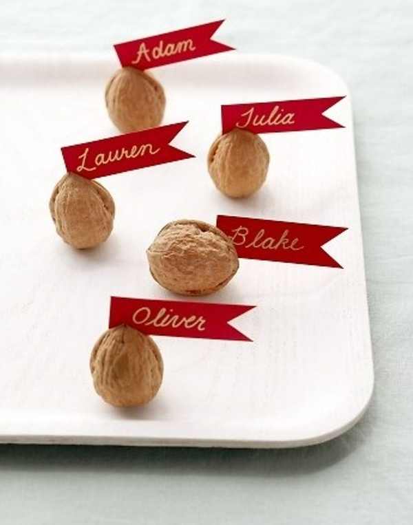 walnuts with tags are nice escort cards for the fall are great for making your fall wedding cooler