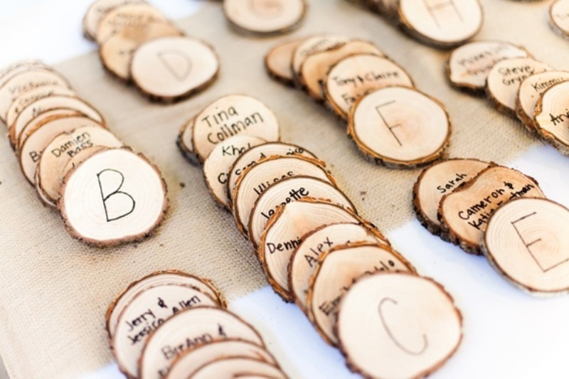 wood slice escort cards will be a nice idea for a fall woodland wedding or any rustic one