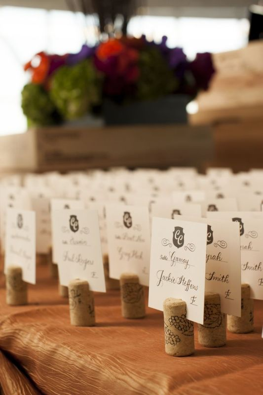 wine corks with cards are lovelt escort cards for a fall vineyard wedding and they can be rocking in other seasons, too