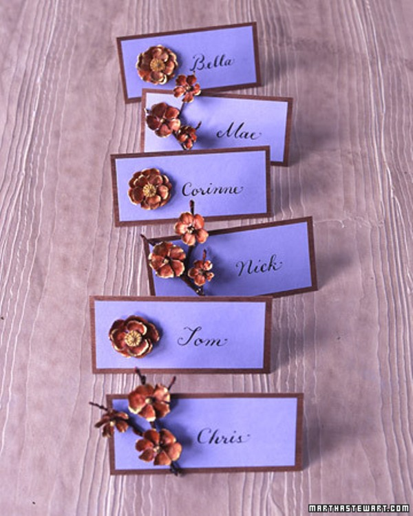 purple framed cards with rust colored brooches are lovely fall wedding escort cards you can rock at the wedding