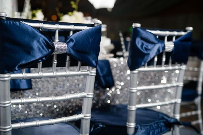 silver chairs with silk navy bows and embellishments will perfectly complete your tablescape look