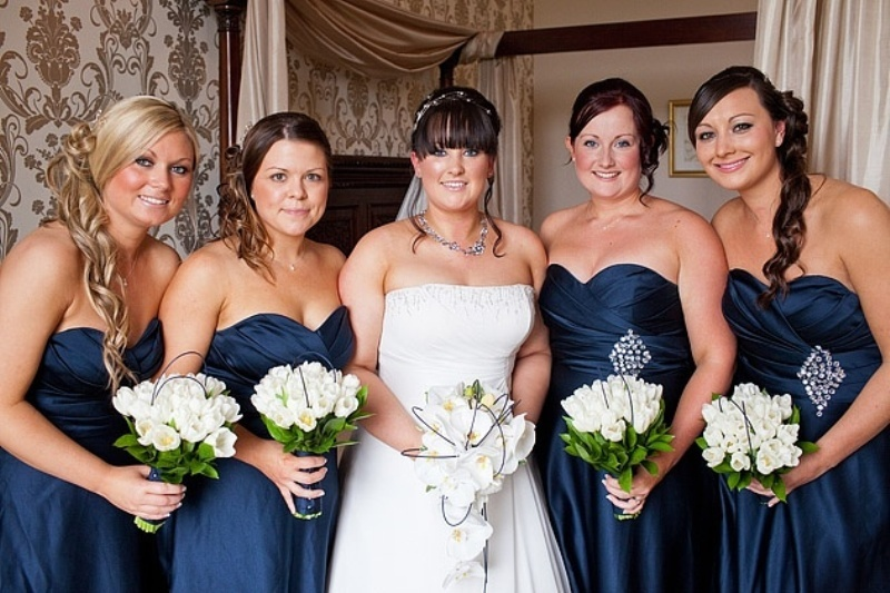 strapless navy bridesmaid dresses accented with silver embellishments look very bold and stylish